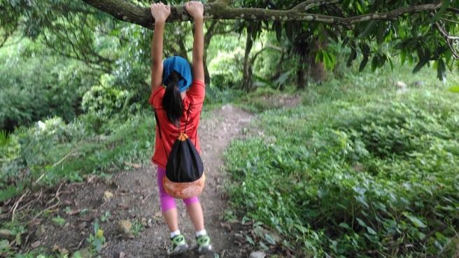 Pia swinging from a mango tree. Photo courtesy of Kim Maribao